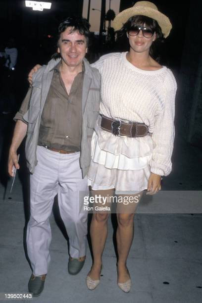 Actor Dudley Moore and wife Brogan Lane attend A Fish Called Wanda Beverly Hills Premiere on July 13 1988 at Academy Theatre in Beverly Hills...