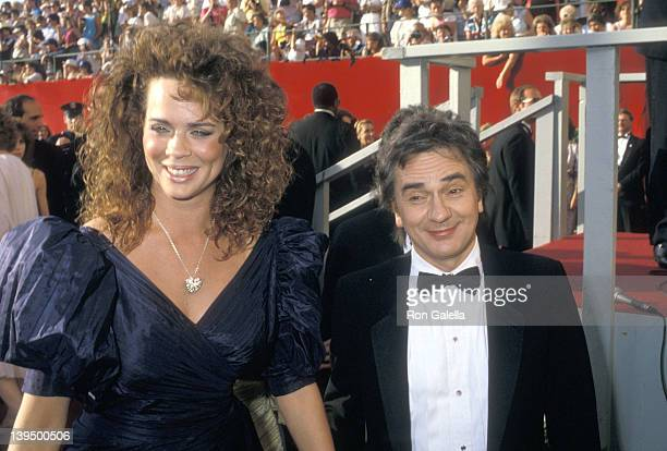Actor Dudley Moore and wife Brogan Lane attend the 60th Annual Academy Awards on April 11 1988 at Shrine Auditorium in Los Angeles California