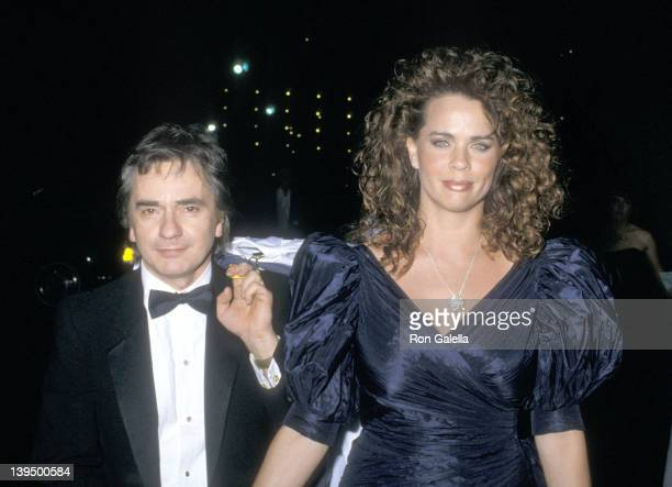Actor Dudley Moore and wife Brogan Lane attend the 60th Annual Academy Awards After Party on April 11 1988 at Spago in West Hollywood California