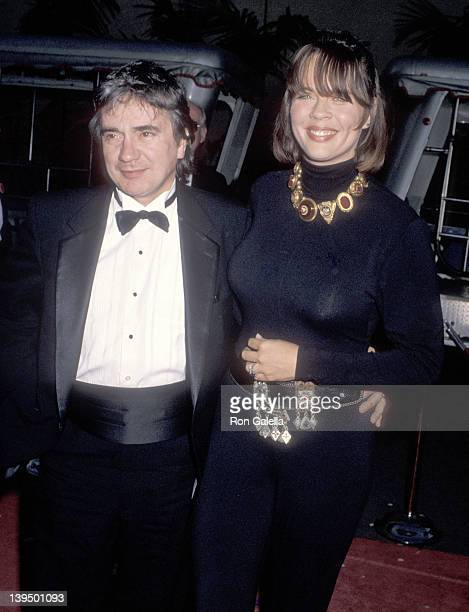 Actor Dudley Moore and wife Brogan Lane attend the Celebration of Tradition A Gala Event Gathering Warner Bros Stars on June 2 1990 at Warner Bros...