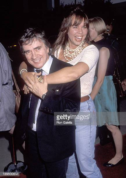 Actor Dudley Moore and wife Brogan Lane attend the HouseSitter Beverly Hills Premiere on June 9 1992 at Academy Theatre in Beverly Hills California