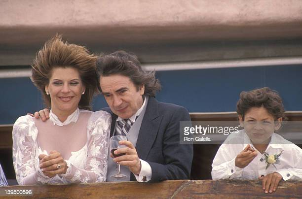 Actor Dudley Moore his new bride Nicole Rothschild and her son Christopher Cleveland greet photographers at their wedding on April 16 1994 at Dudley...