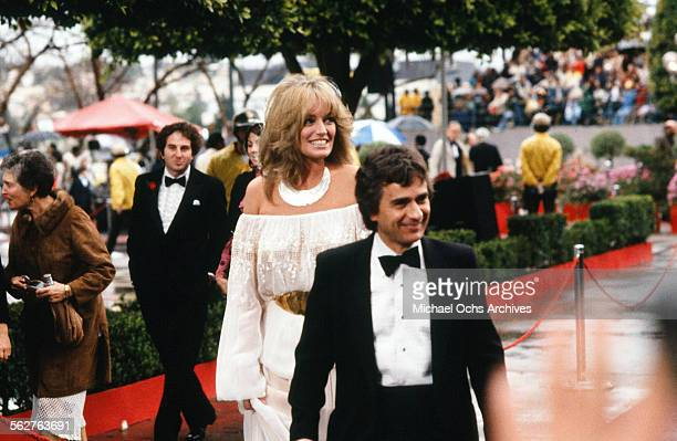 Actor Dudley Moore with actress Susan Anton arrive to the 54th Academy Awards at Dorothy Chandler Pavilion in Los AngelesCalifornia