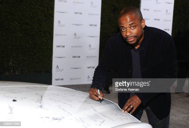 """Actor Dule Hill signs a Chrysler 300 as Vanity Fair Campaign Hollywood 2011 kicks off with Chrysler Celebrating """"The Fighter"""" held at the District on..."""