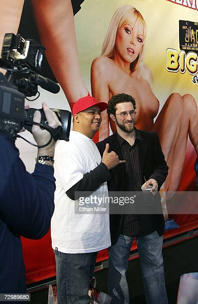 Actor Dustin Diamond poses with a fan as he walks through the Adult Video News Adult Entertainment Expo at the Sands Expo Center January 12 2007 in...