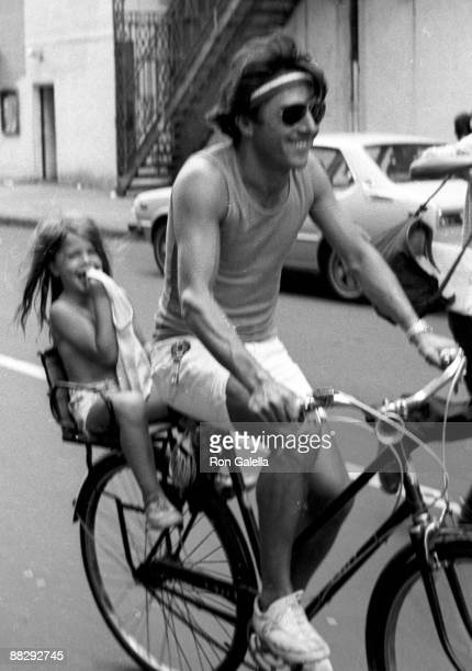 Actor Dustin Hoffman and daughter being photographed riding his bike on April 18, 1976 on West 44th Street in New York City, New York.