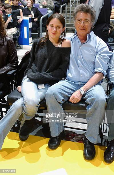 Actor Dustin Hoffman and his daughter Ali smile as they sit courtside during the game between the Toronto Raptors and the Los Angeles Lakers at...