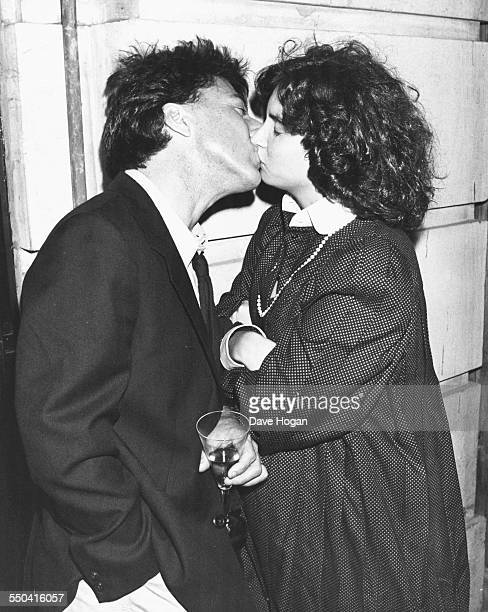 Actor Dustin Hoffman and his wife Lisa kissing outside Langan's Brasserie in London January 1st 1983
