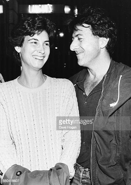 Actor Dustin Hoffman and his wife Lisa laughing together as they leave Langan's Brasserie in London October 20th 1983