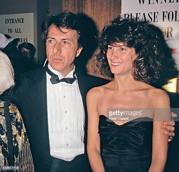 Actor Dustin Hoffman and Lisa Gottsegen arrive at the 1987 Academy Awards�� This image appears on page 30 in Frank Trapper's RED CARPET book