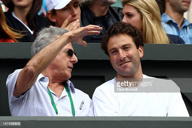 Actor Dustin Hoffman and tennis player Justin Gimelstob attend the Ladies' Singles third round match Serena Williams of the USA and Jie Zheng of...