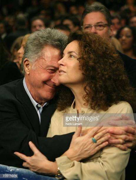 Actor Dustin Hoffman hugs his wife, Lisa Hoffman, during the National Anthem before the start of the IBF & IBO World Heavyweight Championship bout...