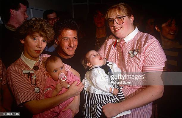 Actor Dustin Hoffman meets nursing staff and patients during a visit to Great Ormond Street Hospital for Children on 5th April 1992 in London,...
