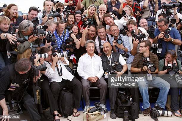 US actor Dustin Hoffman poses among photographers during a photocall for US directors John Stevenson and Mark Osborne animated film 'Kung Fu Panda'...