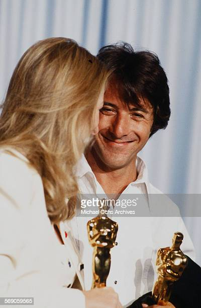 Actor Dustin Hoffman poses backstage with Meryl Streep after winning 'Best Actor' and 'Best Supporting Actress' for 'Kramer vs Kramer' during the...