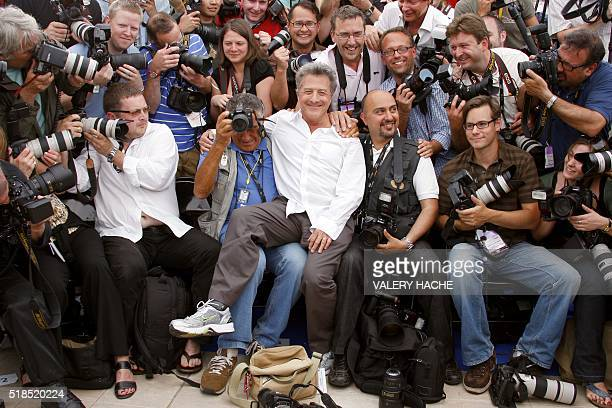 US actor Dustin Hoffman poses with photographers during a photocall for US directors John Stevenson and Mark Osborne animated film 'Kung Fu Panda' at...