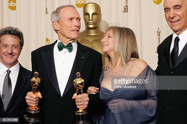 TELECAST*** Actor Dustin Hoffman Producer Clint Eastwood Actress Barbara Streisand and Producer Albert S Ruddy pose with their award for Best Motion...
