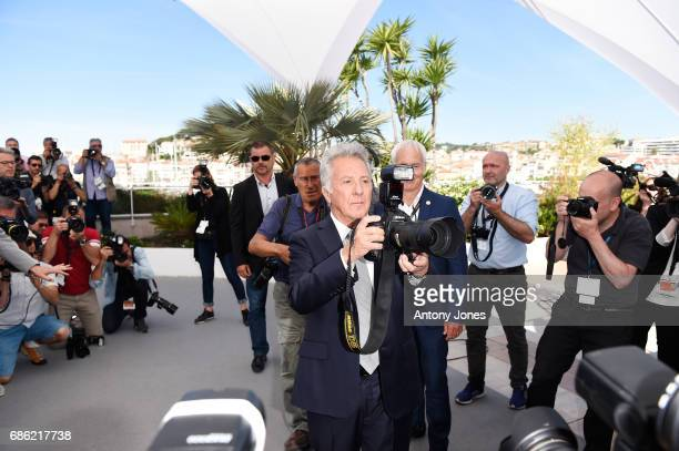 Actor Dustin Hoffman takes a picture as he attends 'The Meyerowitz Stories' photocall during the 70th annual Cannes Film Festival at Palais des...