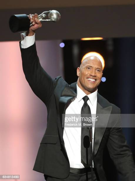 Actor Dwayne Johnson accepts award for Entertainer of the Year onstage at the 48th NAACP Image Awards at Pasadena Civic Auditorium on February 11,...