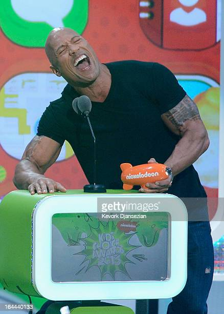 Actor Dwayne Johnson accepts Favorite Male Buttkicker award for Journey 2 The Mysterious Island onstage during Nickelodeon's 26th Annual Kids' Choice...
