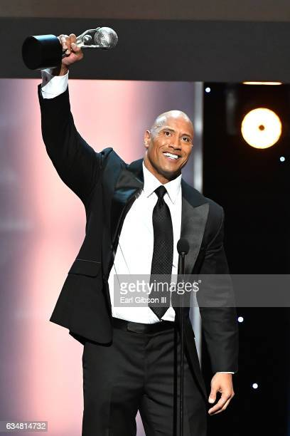 Actor Dwayne Johnson accepts the award for Entertainer of the Year onstage at the 48th NAACP Image Awards at Pasadena Civic Auditorium on February 11...