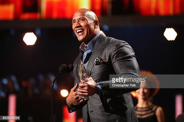 Actor Dwayne Johnson accepts the Favorite Premium Series Actor award for 'Ballers' onstage during the People's Choice Awards 2017 at Microsoft...
