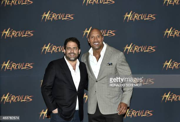 US actor Dwayne Johnson aka The Rock and US director Brett Ratner pose before a press conference in Mexico City on August 18 2014 Johnson and Ratner...