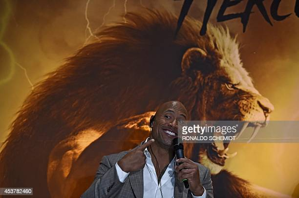 """Actor Dwayne Johnson aka """"The Rock"""" gestures during a press conference in Mexico City, on August 18, 2014. Johnson is in Mexico to promote his new..."""