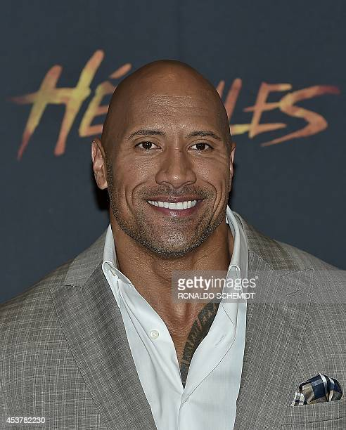 """Actor Dwayne Johnson aka """"The Rock"""" poses before a press conference in Mexico City, on August 18, 2014. Johnson is in Mexico to promote his new movie..."""