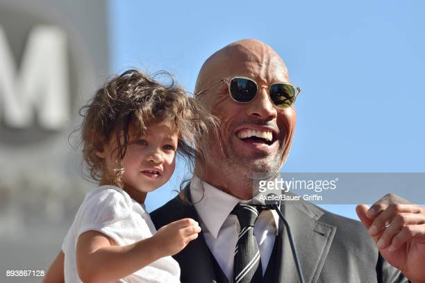 Actor Dwayne Johnson and daughter Jasmine Johnson attend the ceremony honoring Dwayne Johnson with star on the Hollywood Walk of Fame on December 13...