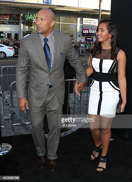 Actor Dwayne Johnson and daughter Simone Alexandra Johnson attend the Hercules Los Angeles Premiere on July 23 2014 at the TCL Chinese Theatre in...