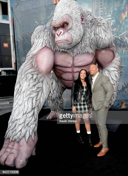 Actor Dwayne Johnson and his daughter Simone Alexandra Johnson arrive at the premiere of Warner Bros Pictures' 'Rampage' at the Microsoft Theatre on...