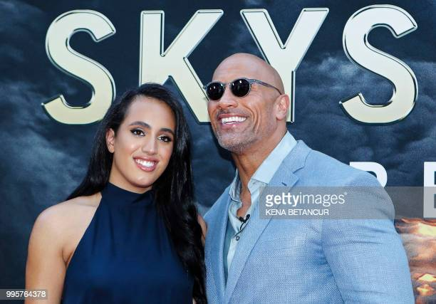 Actor Dwayne Johnson and his daughter Simone Alexandra Johnson attend the premiere of 'Skyscraper' on July 10 2018 in New York City