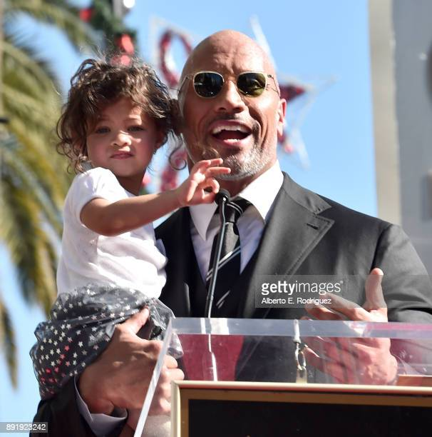 Actor Dwayne Johnson and Jasmine Johnson attend a ceremony honoring Dwayne Johnson with the 2624th star on the Hollywood Walk of Fame on December 13...