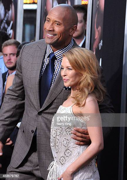 Actor Dwayne Johnson and singer/actress Kylie Minogue arrive at the Los Angeles Premiere 'Hercules' on July 23 2014 at TCL Chinese Theatre in...