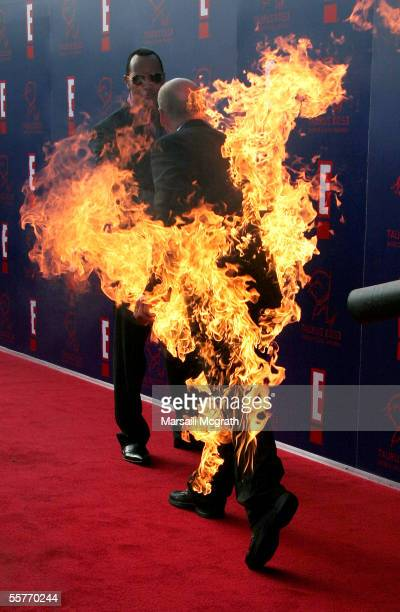 Actor Dwayne Johnson and Stuntman Tim Trella arrives on fire at the 5th Annual Taurus World Stunt Awards on September 25 2005 in Los Angeles...