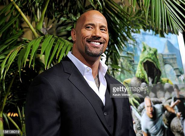 Actor Dwayne Johnson arrives at the premiere of Warner Bros Pictures' 'Journey 2 The Mysterious Island' at the Chinese Theater on February 2 2012 in...