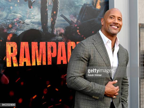 Actor Dwayne Johnson arrives at the premiere of Warner Bros Pictures' 'Rampage' at the Microsoft Theatre on April 4 2018 in Los Angeles California