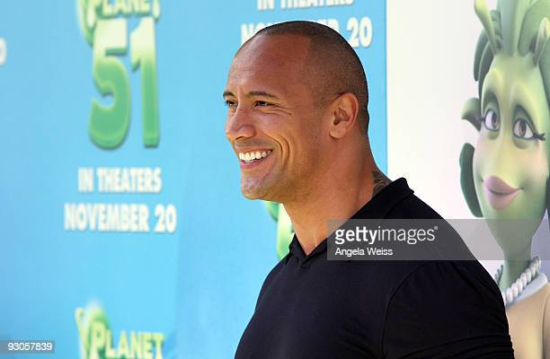 Actor Dwayne Johnson arrives to the premiere of Columbia Pictures' 'Planet 51' at the Mann Village Theatre on November 14, 2009 in Westwood,...
