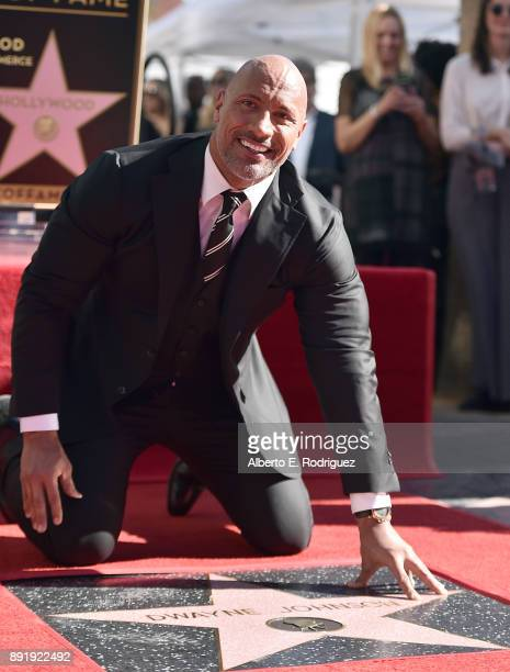 Actor Dwayne Johnson attends a ceremony honoring him with the 2624th star on the Hollywood Walk of Fame on December 13 2017 in Hollywood California