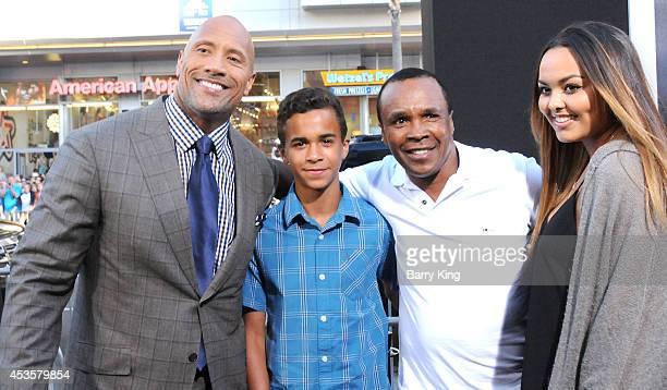 Actor Dwayne Johnson Daniel Ray Leonard Boxer Sugar Ray Leonard and Camille Leonard arrive at the Los Angeles Premiere 'Hercules' on July 23 2014 at...