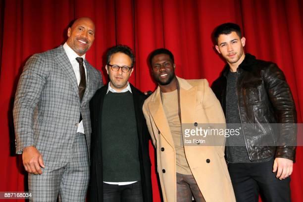 US actor Dwayne Johnson director Jake Kasdan and US actors Kevin Hart and Nick Jonas attend the German premiere of 'Jumanji Willkommen im Dschungel'...