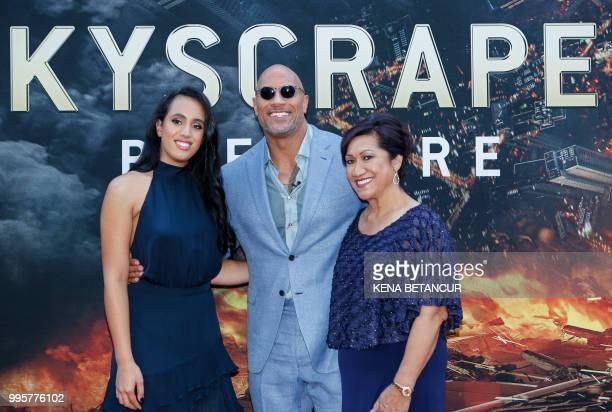 Actor Dwayne Johnson his daughter Simone Alexandra Johnson and his mother Ata Johnson attend the premiere of 'Skyscraper' on July 10 2018 in New York...