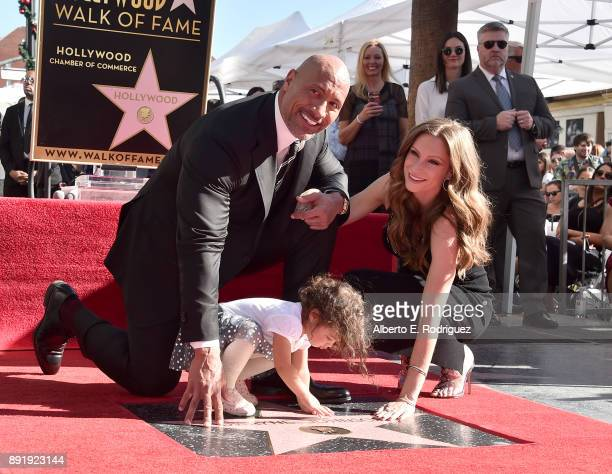 Actor Dwayne Johnson Jasmine Johnson and singer Lauren Hashian attend a ceremony honoring Dwayne Johnson with the 2624th star on the Hollywood Walk...