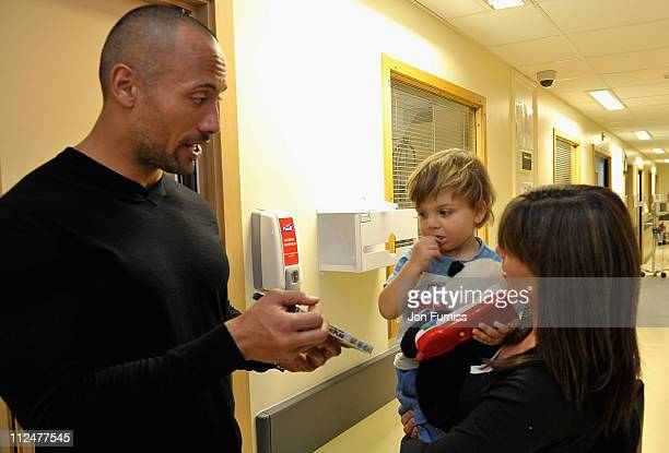 Actor Dwayne Johnson meets Bernadita Jonas and her son Vincent during a visit to Great Ormond Street Hospital for Children following the London...
