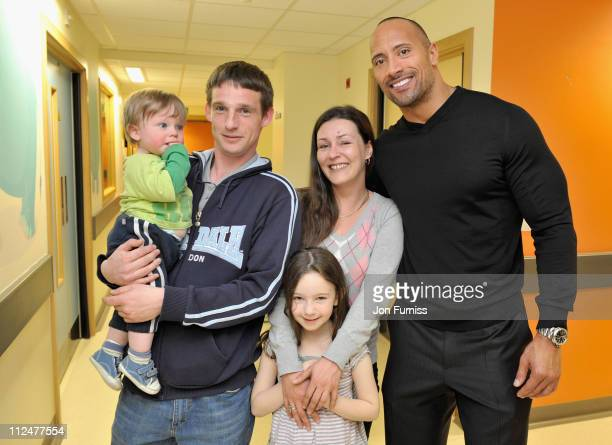 Actor Dwayne Johnson meets Mark Zac Rachael and Ira Lewis during a visit to Great Ormond Street Hospital for Children following the London premiere...