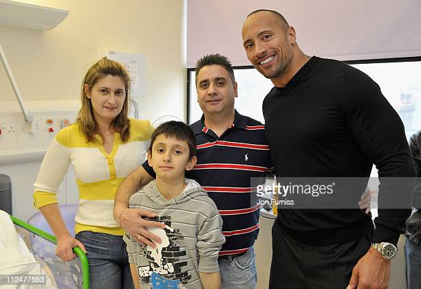 Actor Dwayne Johnson meets Patrick Rua and his parents during a visit to Great Ormond Street Hospital for Children following the London premiere of...