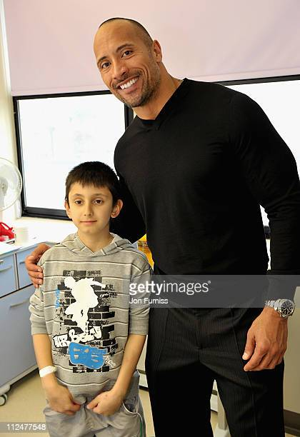 Actor Dwayne Johnson meets Patrick Rua during a visit to Great Ormond Street Hospital for Children following the London premiere of his latest film...