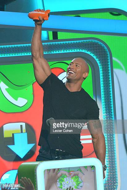 Actor Dwayne Johnson performs during Nickelodeon's 26th Annual Kids' Choice Awards at USC Galen Center on March 23 2013 in Los Angeles California