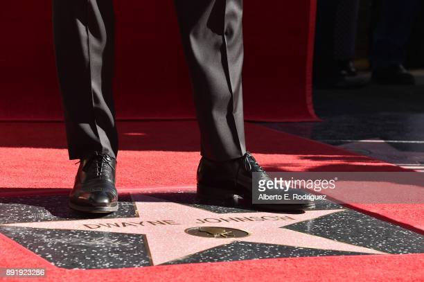 Actor Dwayne Johnson shoe detail attends a ceremony honoring him with the 2624th star on the Hollywood Walk of Fame on December 13 2017 in Hollywood...